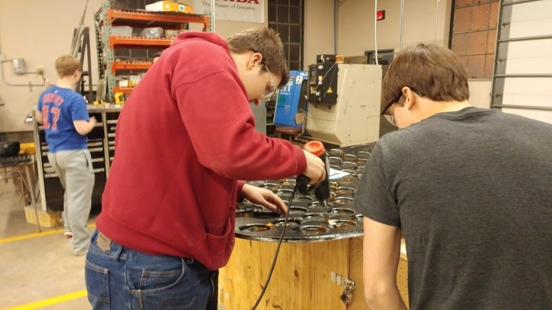 Lucas and Jake work on adding array wiring to the hood of P14